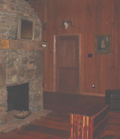 Central stone fireplace highlights this cozy Buffalo River cabin.