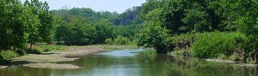 Swimming, canoeing, and rafting add to a great Buffalo River family vacation.